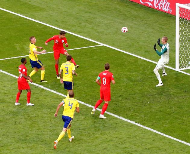 Dele Alli puts the second goal in the net for England. Photo: Reuters