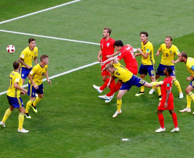 Harry Maguire scores Englands first goal against Sweden at the match in Samara.  Photo: Reuters