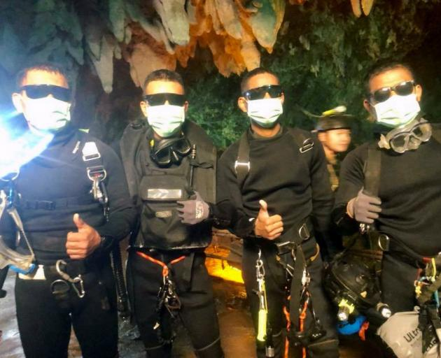 Thai Navy Seals celebrate the successful rescue of 12 boys and their football coach from a cave...
