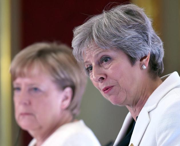 Britain's Prime Minister Theresa May (right) with Germany's Chancellor Angela Merkel. Photo:...