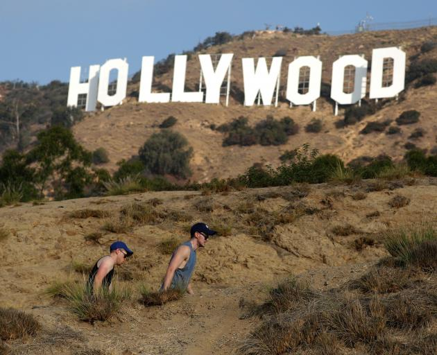 There is no easy way to get close to the sign, apart from a rugged hike from nearby Griffith Park...