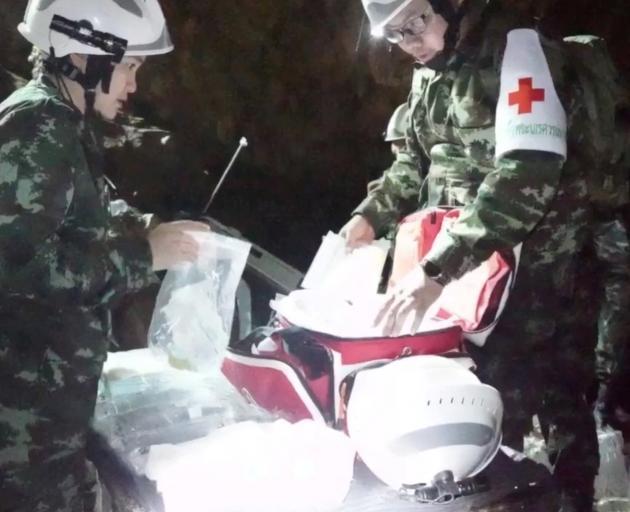 Medical staff at the Tham Luang cave complex. Photo: Thai Navy Seals via Reuters