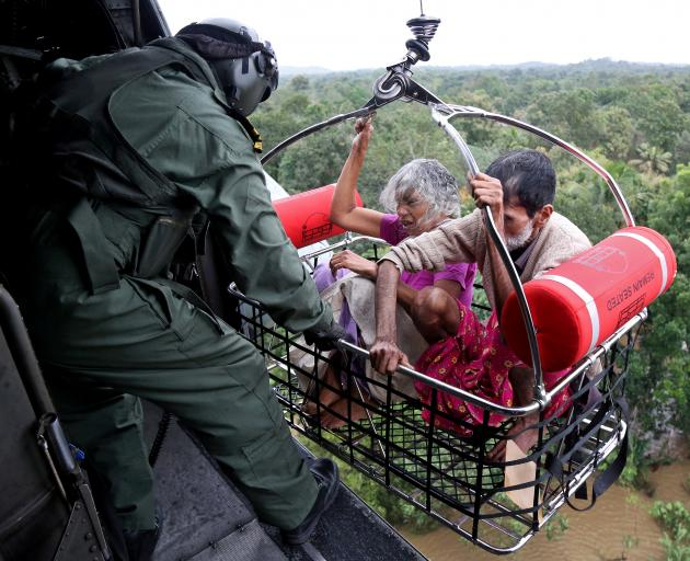 Nearly 40 helicopters are being used to rescue flood victims. Photo: Reuters