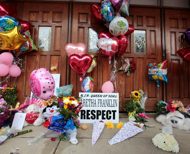 Flowers and other items have been placed outside the New Bethel Baptist Church in Detroit. Photo:...