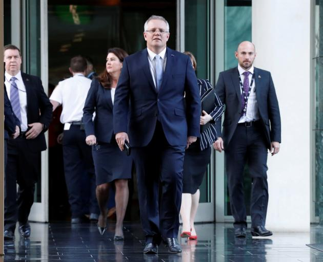 Treasurer of Australia Scott Morrison arrives for a party meeting in Canberra after which he...