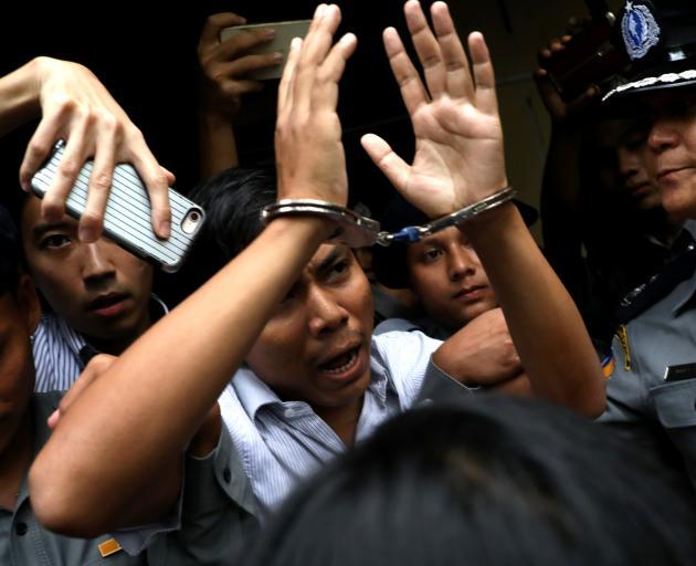 Reuters journalist Kyaw Soe Oo leaving court after the verdict. Photo: Reuters