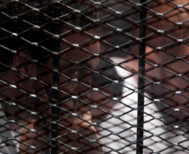 An award-winning photographer who covered the protests,  Mahmoud Abu Zeid, was sentenced to five...