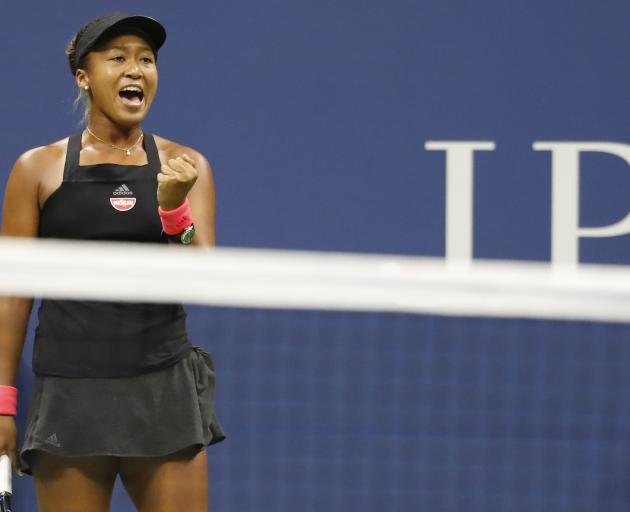 Naomi Osaka celebrates after denying Serena Williams a  record-equalling 24th Grand Slam title....