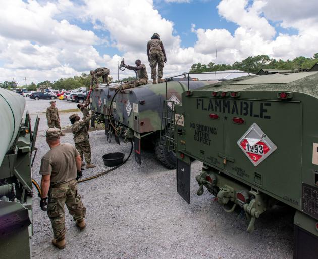 South Carolina National Guard soldiers prepare fuel tanker trucks ahead of Hurricane Florence in...