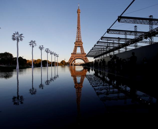 The Eiffel Tower sparkles before the fashion house Saint Laurent's show  during this year's Paris...