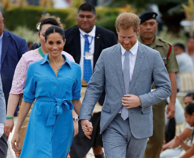 Meghan later changed into a Veronica Beard dress. Photo: Reuters