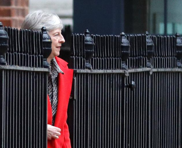 Britain's Prime Minister Theresa May leaving 10 Downing Street via a back exit on Friday. Photo:...