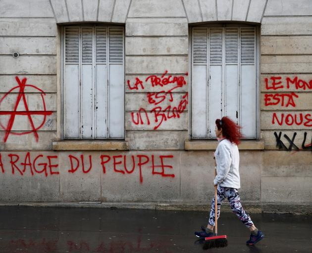 Graffiti written on the facade of a building in Paris. Photo: Reuters