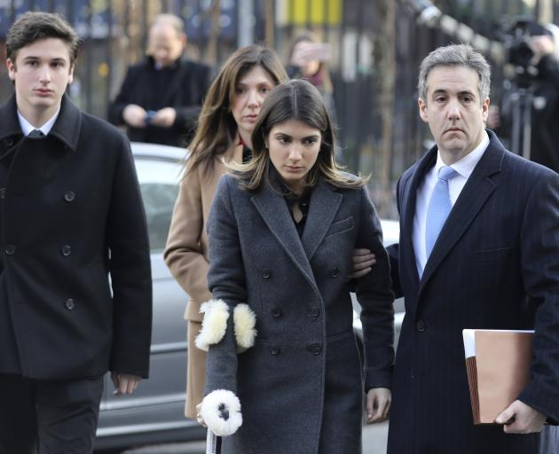 Michael Cohen with his family before sentencing. Photo: Reuters
