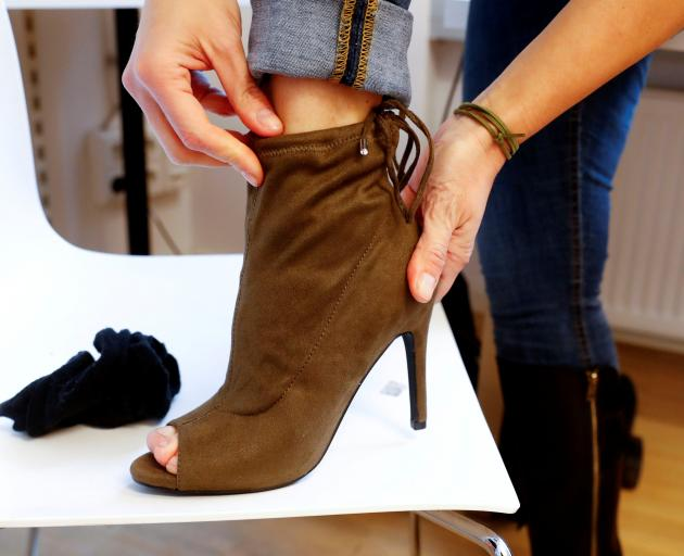 A fitting model checks out sizes for a shoe for sale on Zalando. Photo: Reuters