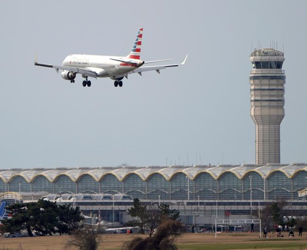 Air traffic controllers at Washington's Regan National Airport are working despite not receiving...