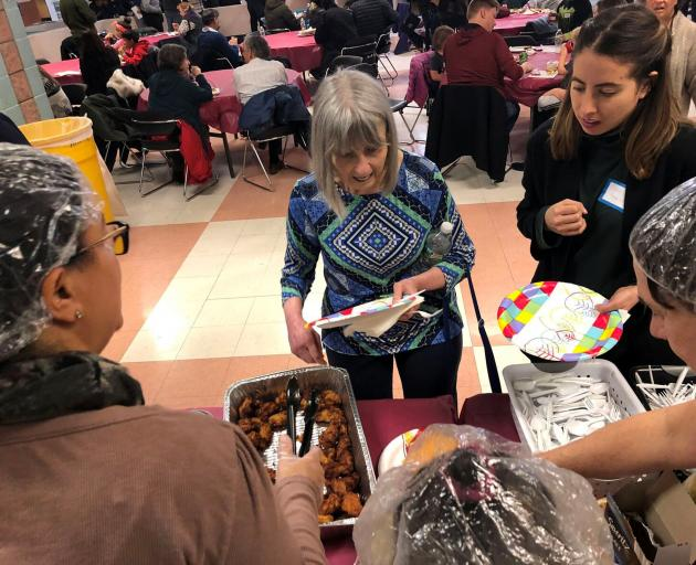 Furloughed government workers, contractors and their families attended a free community dinner...