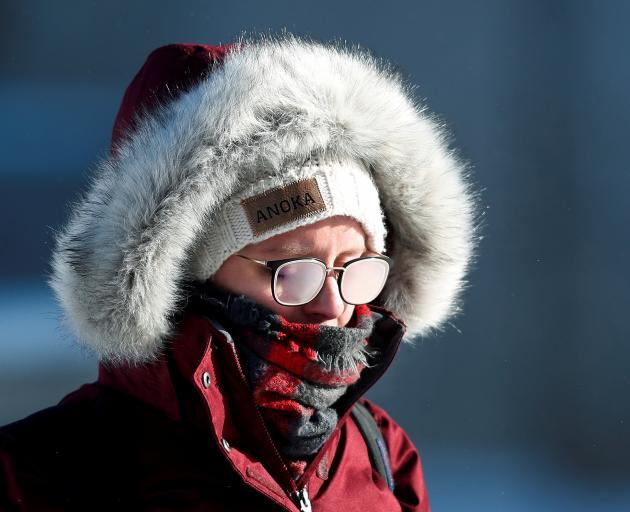 A student's glasses fog in subzero temperatures while walking to class at the University of...