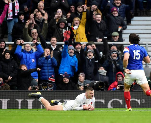 Jonny May scores England's third try. Photo: Reuters