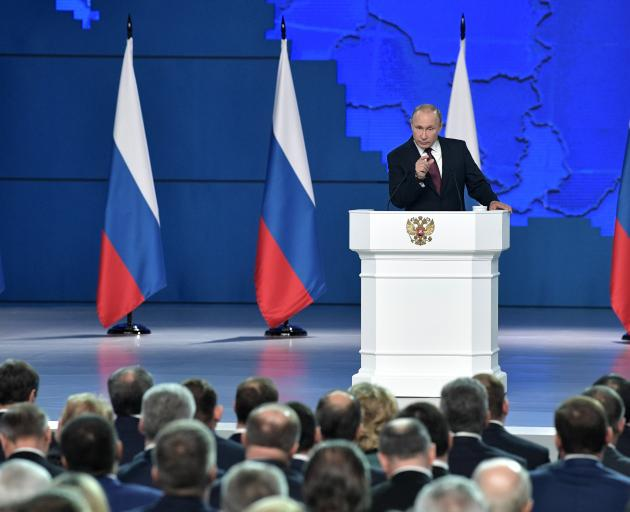 Russian President Vladimir Putin delivers a state-of-the-nation address in Moscow, Russia, this...
