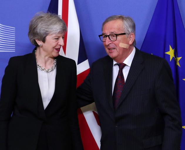 British Prime Minister Theresa May and European Commission President Jean-Claude Juncker. Photo:...