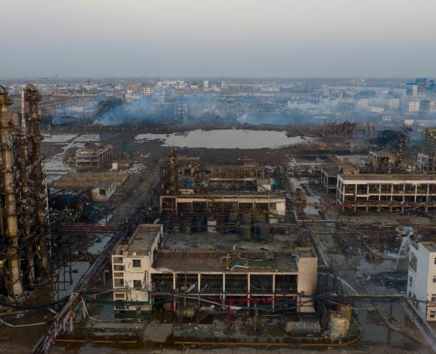 Damaged buildings are seen on the site following an explosion at a pesticide plant in eastern...