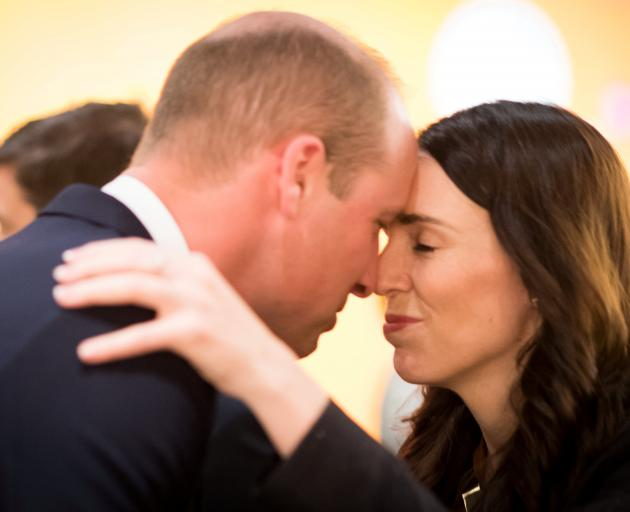 Prince William is welcomed by Prime Minister Jacinda Ardern with a hongi, a traditional Maori...