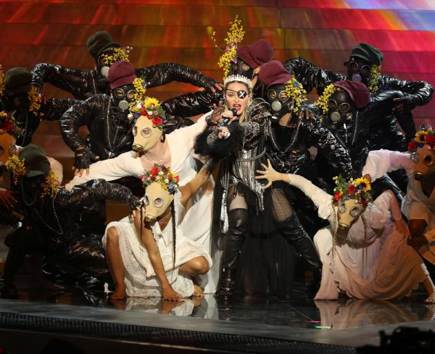 Madonna performs during a guest appearance at the grand final. Photo:  Orit Pnini for KAN via...