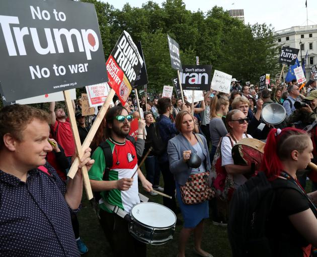 People protest outside Buckingham Palace on Monday during the state visit of Donald Trump. Photo:...