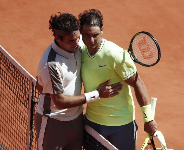 Switzerland's Roger Federer congratulates Rafael Nadal. Photo: Reuters