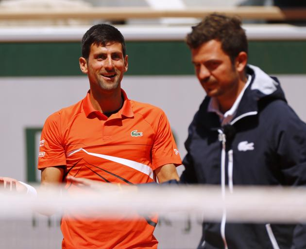 Novak Djokovic was given a time and warning by umpire  Jaume Campistol. Photo: Reuters