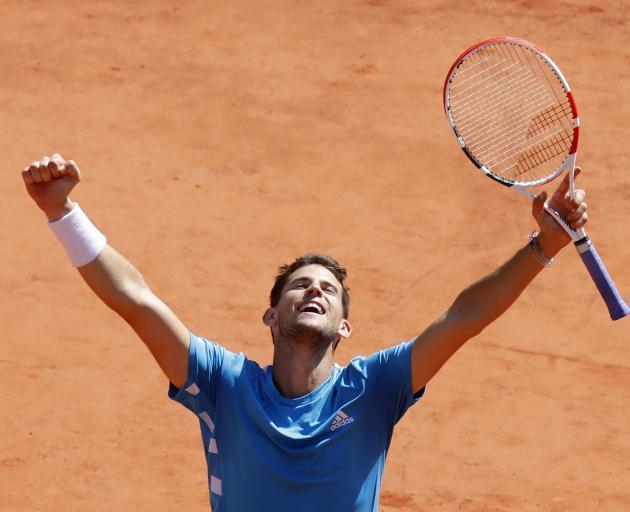 Dominic Thiem celebrates winning an epic semifinal match against Novak Djokovic. Photo: Reuters