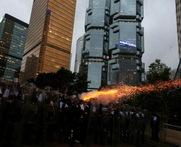 Police fired tear gas into the crowd during the demonstration on Wednesday. Photo: Reuters
