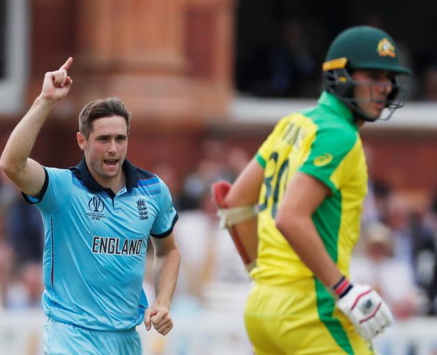 England's Chris Woakes celebrates taking the wicket of Australia's Pat Cummins Action Images via...