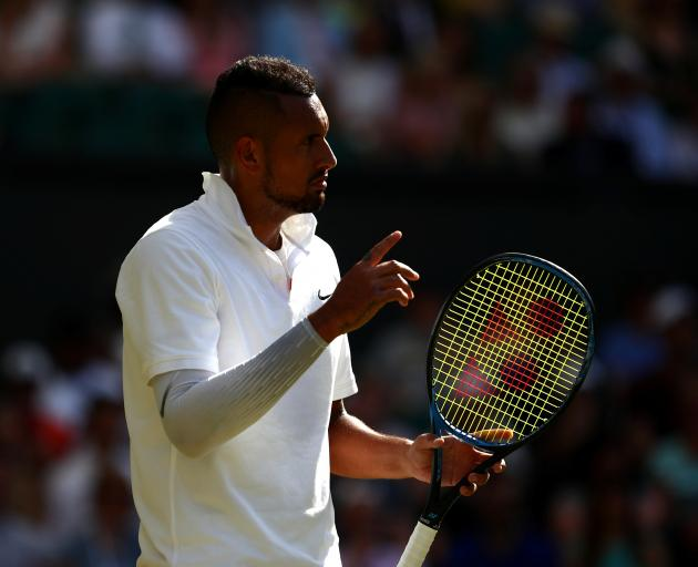 Nick Kyrgios kept up a running dialogue with the umpire, which earned him a warning. Photo: Reuters