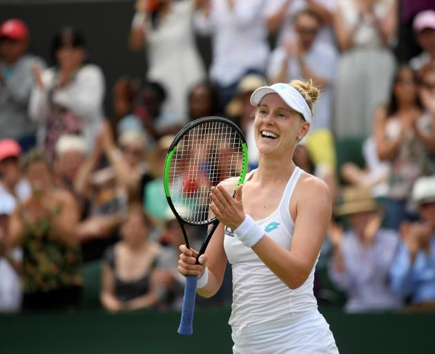 Alison Riske celebrates winning her fourth round match against Ashleigh Barty. Photo: Reuters