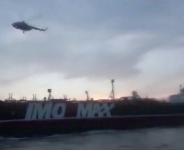 A helicopter hovers over British-flagged tanker Stena Impero. Image: WANA via Reuters