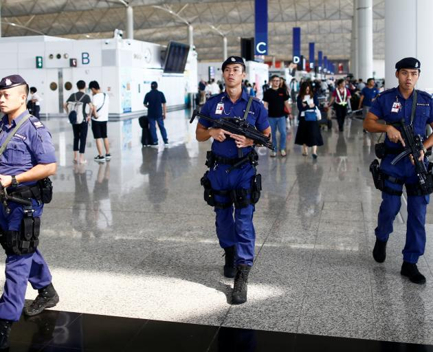 Armed police patrol the departure hall on Wednesday. Photo: Reuters