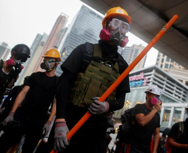 Anti-extradition bill protesters face police on Sunday. Photo: Reuters