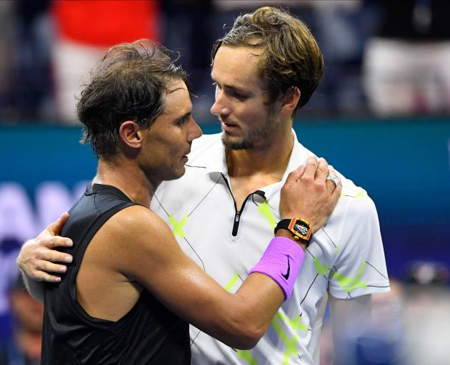 Daniil Medvedev (right) congratulates Rafael Nadal after a match that took nearly five hours....