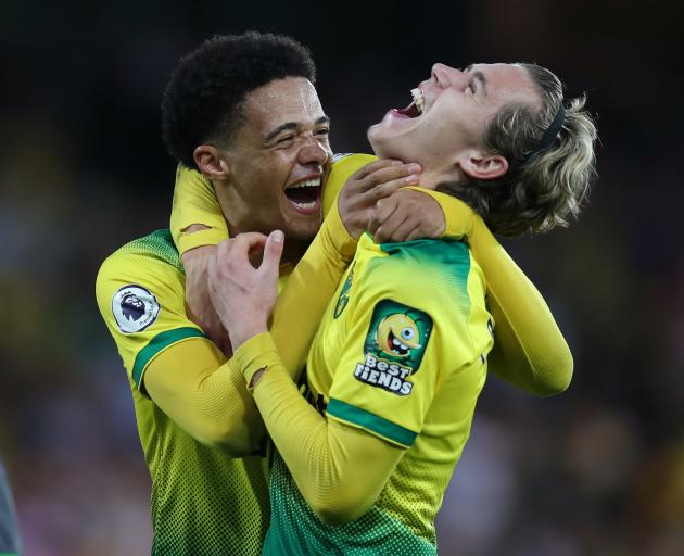 Norwich City's Jamal Lewis and Todd Cantwell celebrate beating Manchester City. Photo: Reuters