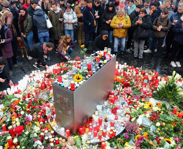 Mourners gather at the market square in Halle on Thursday. Photo: Reuters