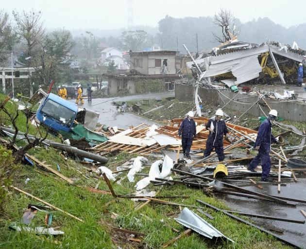 Destroyed houses, cars and power poles in Ichihara, east of Tokyo on Saturday. Photo: Kyodo via...