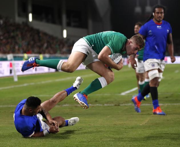 Ireland's Jordan Larmour scores their fifth try. Photo: Reuters