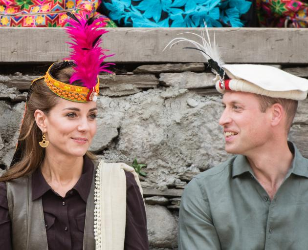 The royal couple also visited a settlement of the Kalash people and wore colourful headwear....