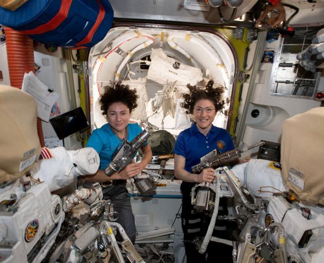 Jessica Meir (left) and Christina Koch aboard the International Space Station. Photo: NASA via...
