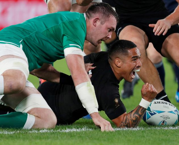 An elated Aaron Smith scores the first try for the All Blacks. Photo: Reuters