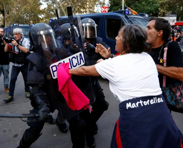 Catalan demonstrators scuffle with riot police during Saturday's protest in central Barcelona....