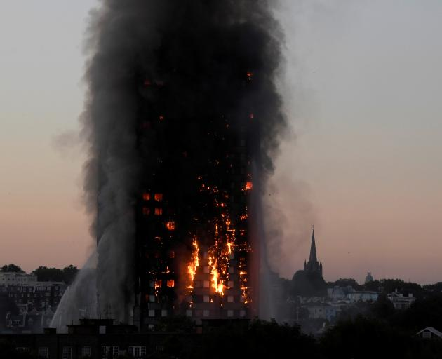 Flames and smoke billow from the West London building. Photo: Reuters