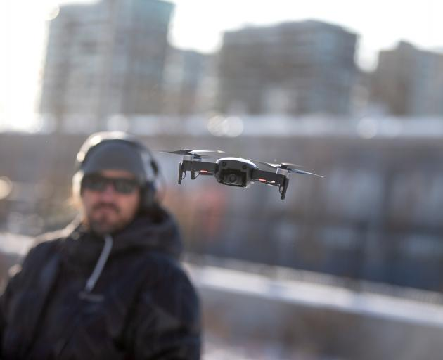 DJI demonstrated its drone-to-phone transmission app at the UN aviation agency's Drone Enable...